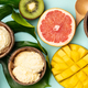 Tropical fruits and plants with variety of ice cream in coconut shells - PhotoDune Item for Sale