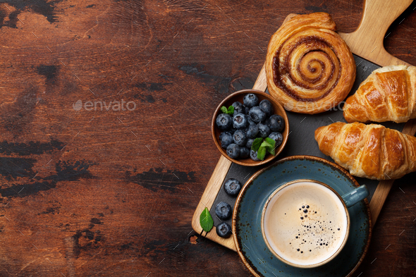 Coffee and croissants breakfast - Stock Photo - Images