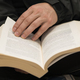 Man hands holding a book with dog-ears. - PhotoDune Item for Sale