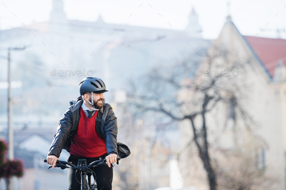 Hipster businessman commuter with bicycle traveling to work in city. - Stock Photo - Images