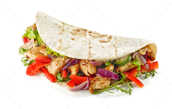 Tortilla wrap with fried chicken meat and vegetables - Stock Photo - Images