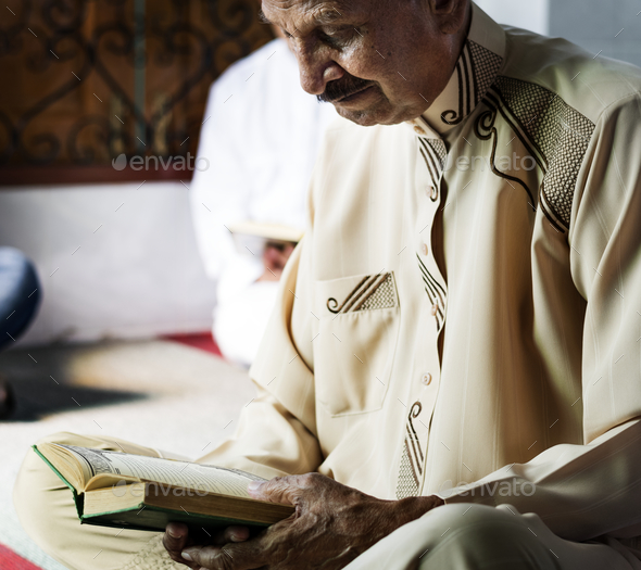 Muslims reading from the quran - Stock Photo - Images