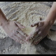 Process of cooking homemade dough. Woman's hands gather flour in a heap on a table. Slow motion - PhotoDune Item for Sale