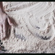Female chef's is hand mowing flour on a wooden table for homemade dough. Top view. Slow motion - PhotoDune Item for Sale