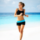 Woman running on the beach - PhotoDune Item for Sale