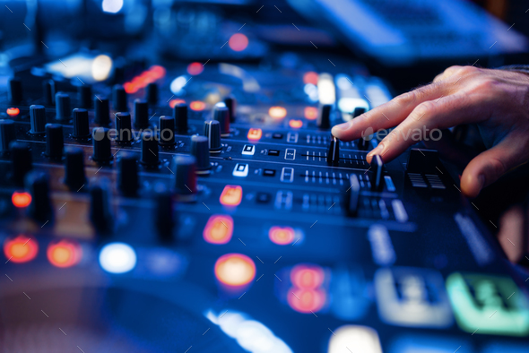 Sound operator hands at the volume control panel - Stock Photo - Images