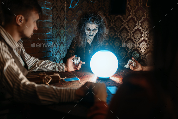 Witch, man and woman on spiritual seance - Stock Photo - Images