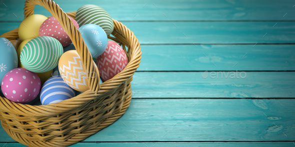 Easter eggs in a basket on the green wooden planks. - Stock Photo - Images