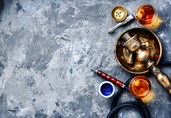 Smoking hookah with brandy flavor - Stock Photo - Images