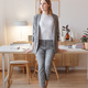 Young boss woman in a gray stylish suit stands in her own creative office - PhotoDune Item for Sale