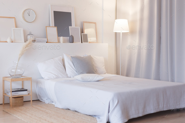 modern bedroom with floor lamp and decorations - Stock Photo - Images