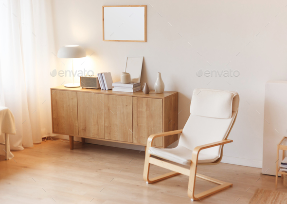 Modern minimalistic interior with chest of drawers an braided armchair. Scandinavian style. - Stock Photo - Images