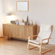 Modern minimalistic interior with chest of drawers an braided armchair. Scandinavian style. - PhotoDune Item for Sale