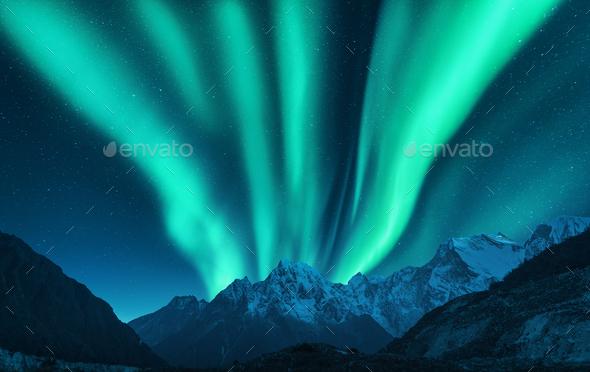 Aurora borealis above snow covered mountain range in europe - Stock Photo - Images