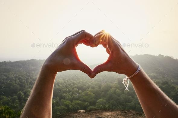 Heart shape against sunset - Stock Photo - Images