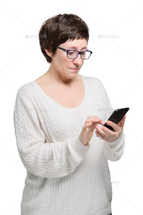 Brunette woman in glasses makes purchases in the online store with phone and credit card - Stock Photo - Images