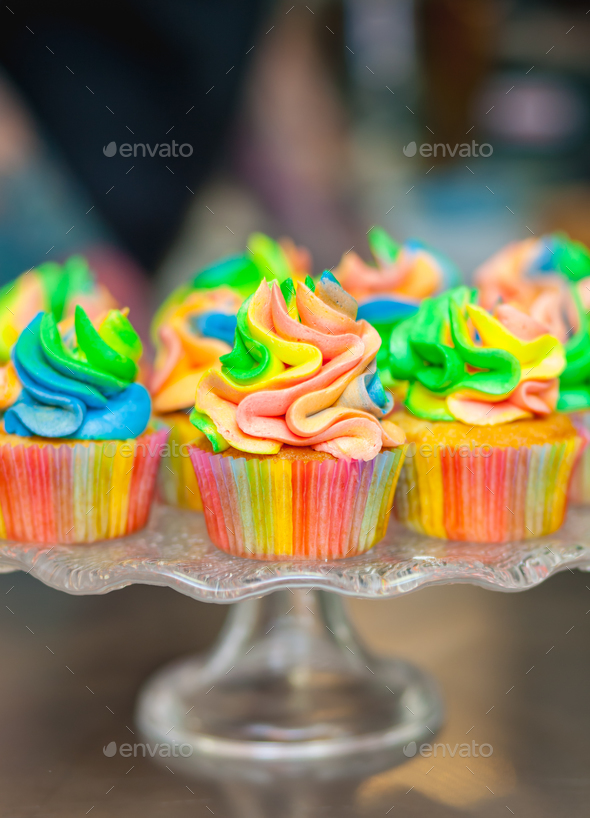 Colorful cupcakes with rainbow cream. - Stock Photo - Images