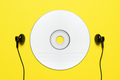 Blank CD and headphones on yellow background - PhotoDune Item for Sale