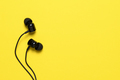 Earbuds on yellow background with text space - PhotoDune Item for Sale