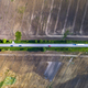 Aerial view of a country road between agricultural fields in Europe - PhotoDune Item for Sale