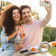 Photo of cute couple man and woman taking selfie on mobile phone - PhotoDune Item for Sale