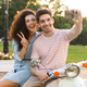 Photo of pretty couple man and woman taking selfie on mobile pho - PhotoDune Item for Sale