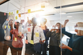 Ecstatic group of businesspeople cheering together during a brainstorming session - PhotoDune Item for Sale