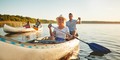 Smiling woman canoeing with friends on a lake in summer - PhotoDune Item for Sale