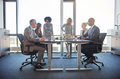 Diverse colleagues talking together in a boardroom in an office - PhotoDune Item for Sale