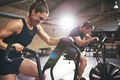 Man and woman hardly exercising at gym - PhotoDune Item for Sale