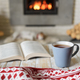 Book and cup of tea near fireplace - PhotoDune Item for Sale