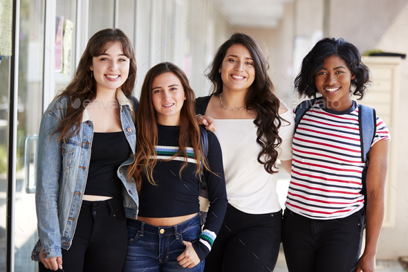 Portrait Of Smiling Female College Student Friends In Corridor Of Building - Stock Photo - Images