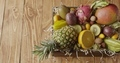 Panoramic video top view on a box with variety fresh natural organic exotic fruits on a wooden - PhotoDune Item for Sale