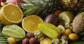 Assorted tropical fruits - halves of orange, pineapple, carambola, coconut and lichi with watering - PhotoDune Item for Sale