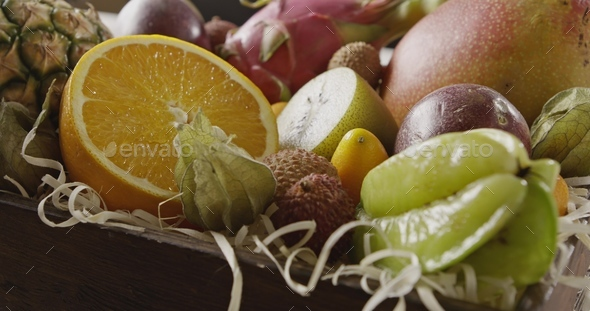 Close up view on a wooden box with fresh exotic fruits. Panoramic motion, 4K UHD video, 3840, 2160p - Stock Photo - Images