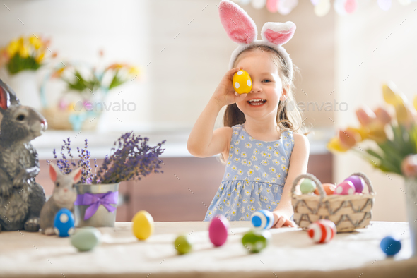Girl with painted eggs - Stock Photo - Images