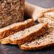 Loaf of wholegrain bread for breakfast and ears of rye or wheat grain - PhotoDune Item for Sale