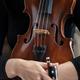 woman in black turtleneck holds violin - PhotoDune Item for Sale