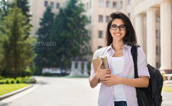 Smiling beautiful student girl outdoor - Stock Photo - Images