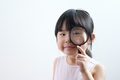 Little girl child looking through a magnifying glass on white background - PhotoDune Item for Sale