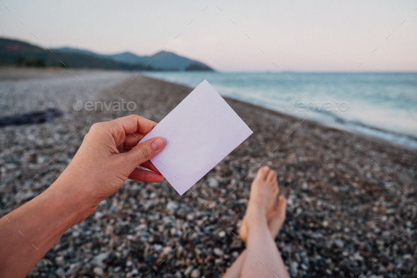 Empty paper note in hand  - Stock Photo - Images