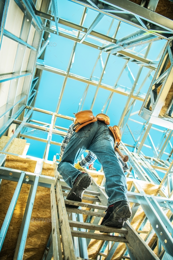 Construction Worker on a Ladder - Stock Photo - Images