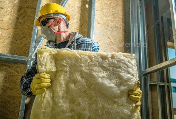 Worker with Wool Insulation - Stock Photo - Images
