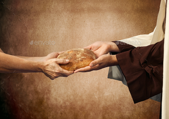 Jesus gives the bread to a beggar. - Stock Photo - Images