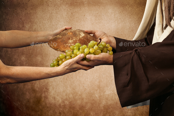 Jesus gives bread and grapes - Stock Photo - Images