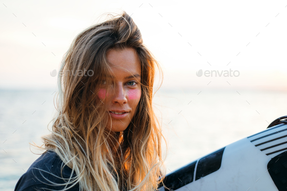 Surfer girl on beach - Stock Photo - Images