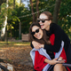 Girl hugging her friend. Portrait Two girlfriends in the park - PhotoDune Item for Sale