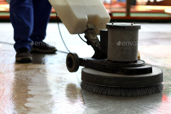 Cleaning machine washing the floor in a shopping mall - Stock Photo - Images