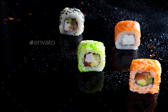 Colorful sushi sets with lots of sushi, roll . Stylish sushi sets on a black background with water - Stock Photo - Images