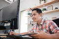 man working in home office seriously look at computer - PhotoDune Item for Sale